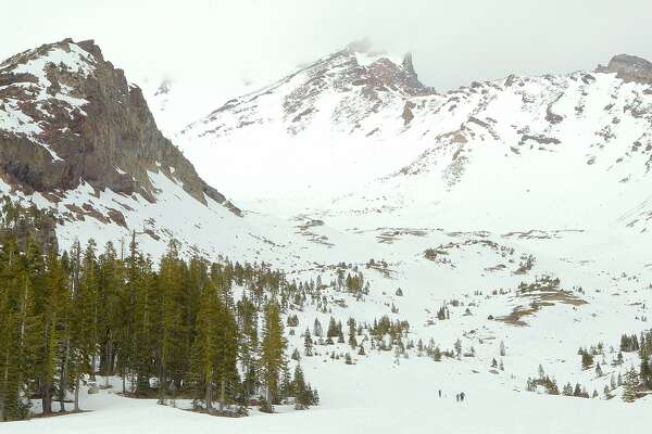 "A group of cross-county skiers trek to the foot of the ""Ski Bowl"" to sail down 2.5 miles to the trailhead at Bunny Flat, where thousands of travelers on I-5 break off and visit each day."