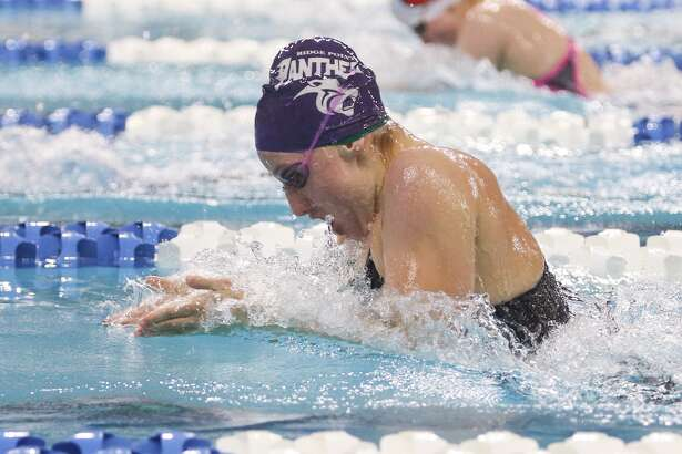 Kylie Powers, of Fort Bend Ridge Point, competes in the girls 100-yard breaststroke during the Class 5A finals of the UIL State Swimming & Diving Championships at the Lee and Joe Jamaul Texas Swimming Center. To view this photos and others like it from the championships, go to HCNPics.com.