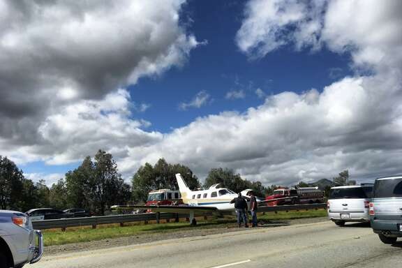 The pilot of a small plane made an emergency landing Sunday in the middle of a highway in Morgan Hill, officials said.