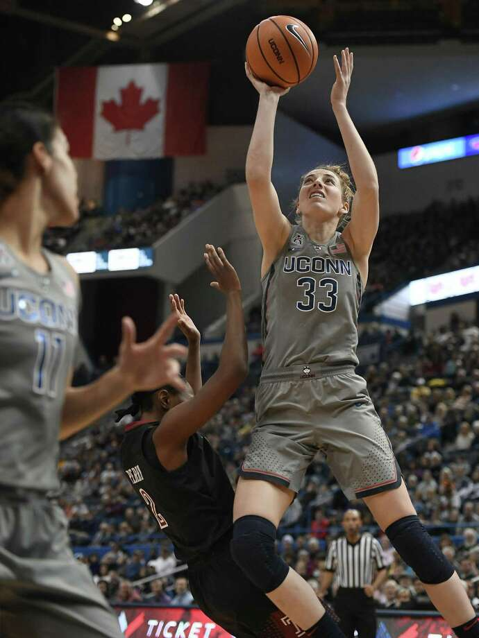 UConn's Katie Lou Samuelson is fouled by Temple's Breanna Perry Sunday in Hartford. Photo: Jessica Hill / Associated Press / AP2018