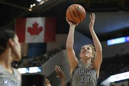 UConn's Katie Lou Samuelson is fouled by Temple's Breanna Perry Sunday in Hartford.