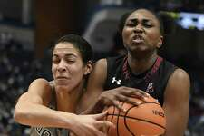 UConn's Kia Nurse, left, fights for a rebound with Temple's Breaana Perry Sunday in Hartford.