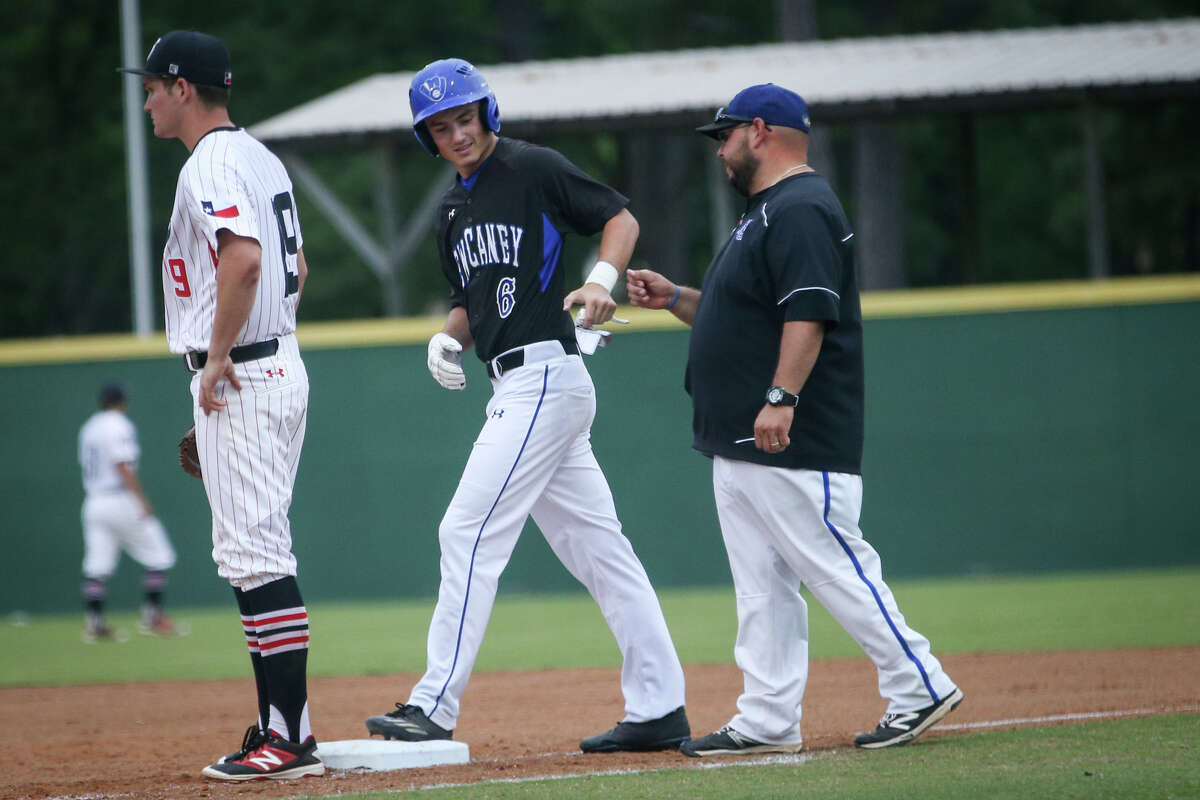 New Caney's Jonathan Plunkett (6) fist bumps varsity assistant coach Carlos Chapa after getting on base during the varsity baseball game on Tuesday, April 25, 2017, at Porter High School. (Michael Minasi / Houston Chronicle)