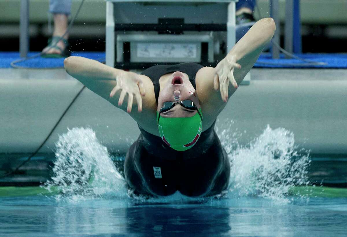 Lucie Norman of The Woodlands competes in the Class 6A girls 100-yard backstroke during the Class 6A UIL State Swimming & Diving Championships at the Lee and Joe Jamail Texas Swim Center on Saturday, Feb. 17, 2018, in Austin.