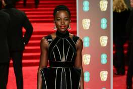 Lupita Nyong'o attending the EE British Academy Film Awards held at the Royal Albert Hall, Kensington Gore, Kensington, London. (Photo by Ian West/PA Images via Getty Images)