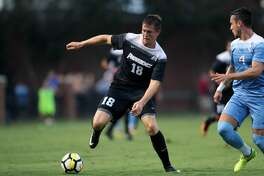 ELON, NC - AUGUST 25: Providence's Mac Steeves (18) and North Carolina's Alex Comsia (CAN) (4). The University of North Carolina Tar Heels hosted the Providence College Friars on August 25, 2017 at Rudd Field in Elon, NC in a Division I college soccer game. UNC won the game 4-2. (Photo by Andy Mead/YCJ/Icon Sportswire via Getty Images)