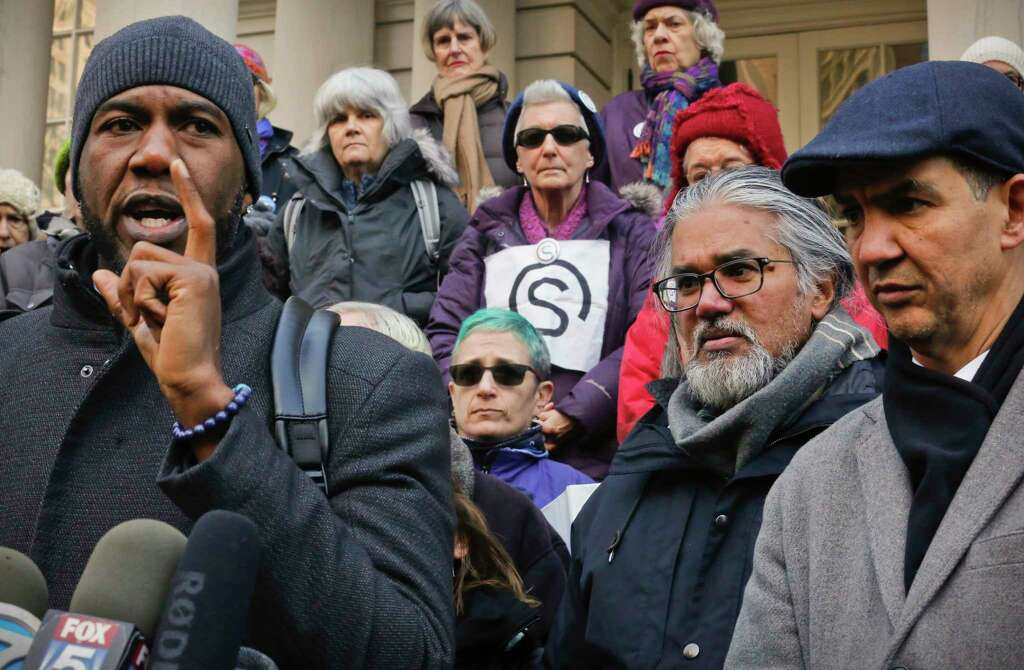 Council members Jumaane Williams, far left, and Ydanis Rodriguez, far right, hold a press conference on behalf of Ravi Ragbir, second from right, a citizen of Trinidad and Tobago and executive director of the New Sanctuary Coalition of New York City, Wednesday Jan. 31, 2018, at New York City Hall. Williams and Rodriguez were arrested as they attempted to block authorities from taking Ragbir into custody on Jan. 11 after a routine check-in with immigration officials in New York. A federal judge on Monday ordered authorities to immediately release Ragbir on the grounds he hadn't been given enough time to say goodbye to his family.