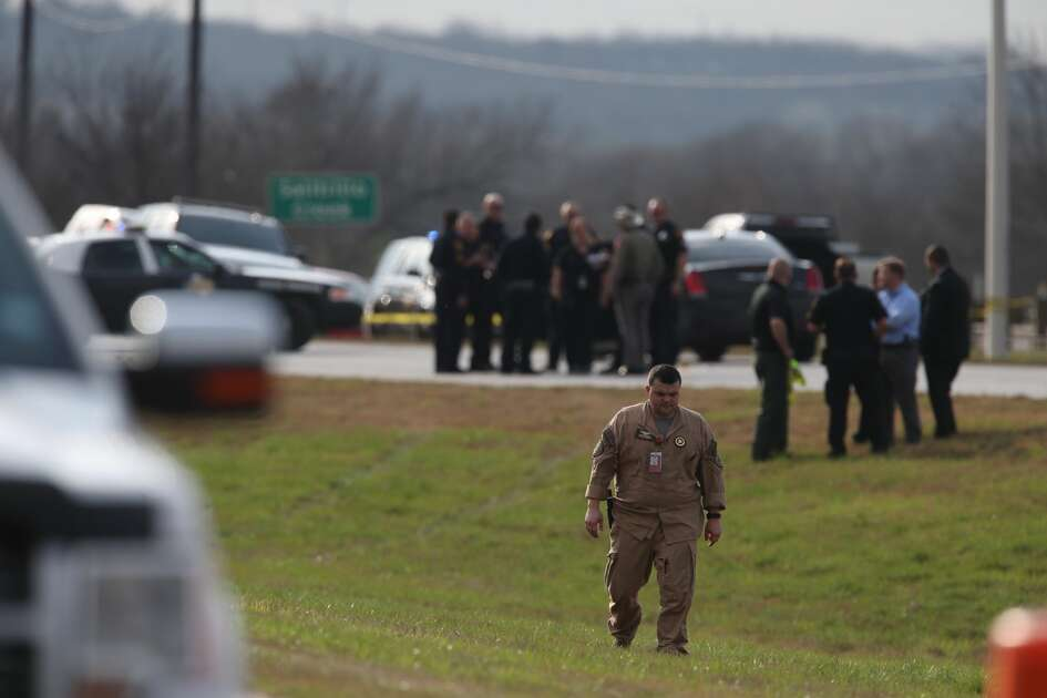 Law enforcement personnel investigate the scene of a shooting involving Texas State Troopers at IH-10 East at Graytown Road, Sunday, Feb. 18, 2018.