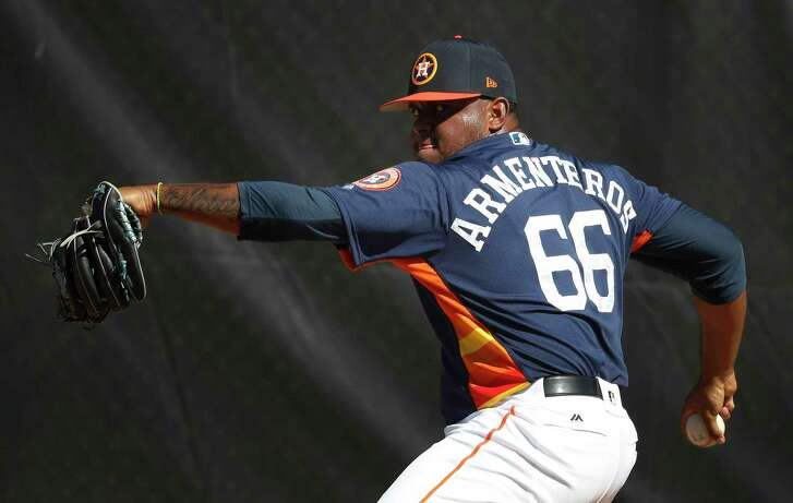 Houston Astros RHP pitcher Rogelio Armenteros (66) throws as the pitchers and catchers worked out during spring training at The Ballpark of the Palm Beaches, Thursday, Feb. 15, 2018, in West Palm Beach.