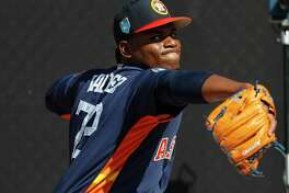 Houston Astros LHP pitcher Framber Valdez (72) pitches as the pitchers and catchers worked out during spring training at The Ballpark of the Palm Beaches, Thursday, Feb. 15, 2018, in West Palm Beach.