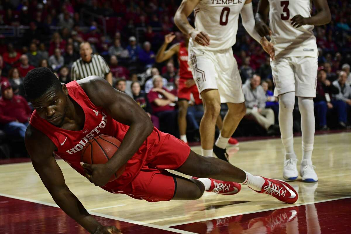 PHILADELPHIA, PA - FEBRUARY 18: Nura Zanna #13 of the Houston Cougars loses his footing against the Temple Owls during the first half at the Liacouras Center on February 18, 2018 in Philadelphia, Pennsylvania. (Photo by Corey Perrine/Getty Images)
