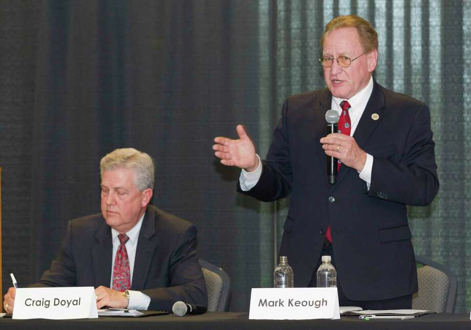 State Rep. Mark Keough, Republican candidate for Montgomery County Judge, speaks next to incumbent Craig Doyal during the Conroe/Lake Conroe Chamber of Commerce candidate forum at the Lone Star Convention & Expo Center, Tuesday, Feb. 6, 2018, in Conroe. Photo: Jason Fochtman, Staff Photographer / © 2018 Houston Chronicle