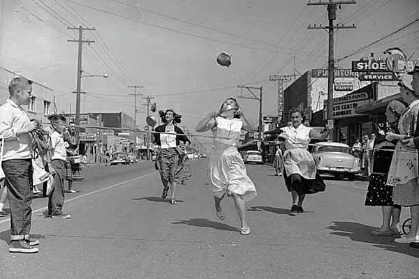 Pancake flipping race at Pancake Festival, White Center, 1956.