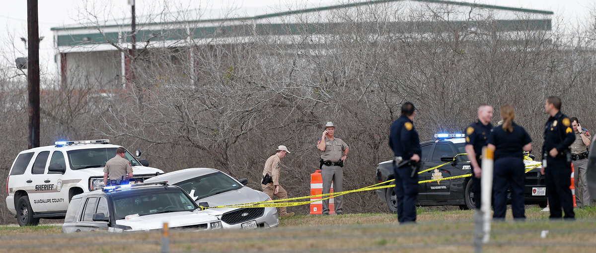 Emergency personnel work the scene where a DPS officer was shot Sunday Feb. 18, 2018 at IH-10 and Graytown Road.