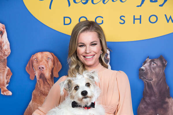?2018 American Rescue Dog Show? features shelter dogs of various breeds from across the country vying for top dog in the world?s most adorable categories. The goal of the show is to inspire viewers to adopt their next dog from their local shelter or rescue organization.  The three-hour special is hosted by Rebecca Romijn and Rich Eisen, with celebrity judges Linda Blair, Rick Springfield, Brandon McMillan, Ross Matthews, Andrea Arden and Larissa Wohl covering all the action ringside.  Photo: Rebecca Romijn, Happy the Dog  Credit: © 2018 Crown Media United States, LLC | Photo: Alexx Henry Studios, LLC / jeremy lee