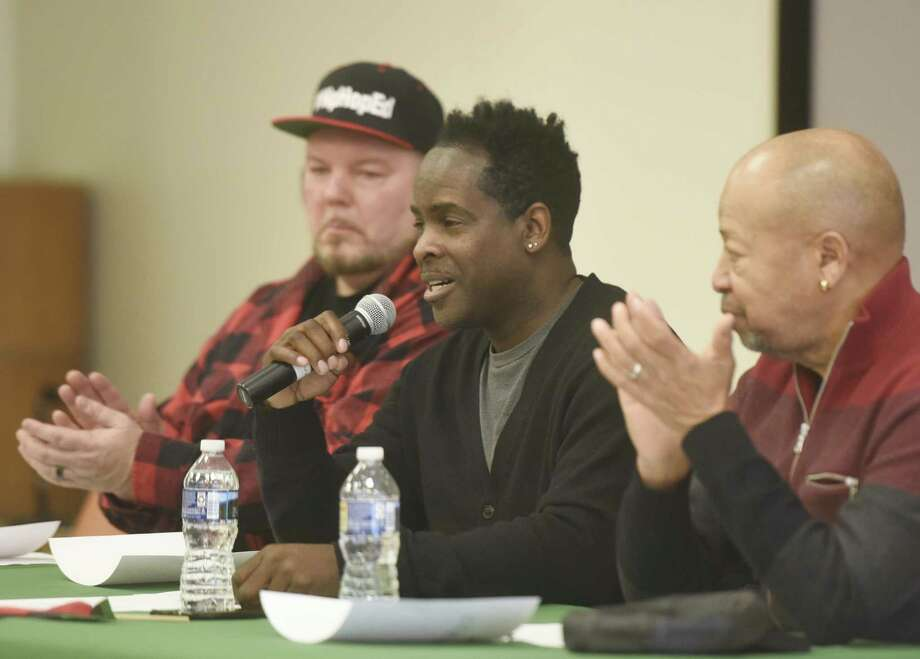 Song writer and vocalist Robbie Jenkins, center, speaks beside performer and song writer David Wooley, left, and vocalist Richard Thomas during the panel discussion at the Black History Month Open Mic Competition at Ferguson Memorial Library in Stamford, Conn. Sunday, Feb. 18, 2018. Panelists discussed hip hop music and the entertainment industry before judging the Black History-themed open mic contest, including spoken word, song, and instrumental performances. Photo: Tyler Sizemore / Hearst Connecticut Media / Greenwich Time
