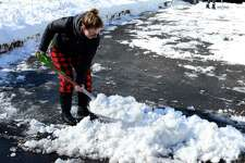Crystal Lamancusa, left, and Lindsey Gatto, both from Danbury shovel the snow off their driveway after a winter storm covered the ground overnight. Sunday February 18, 2018.