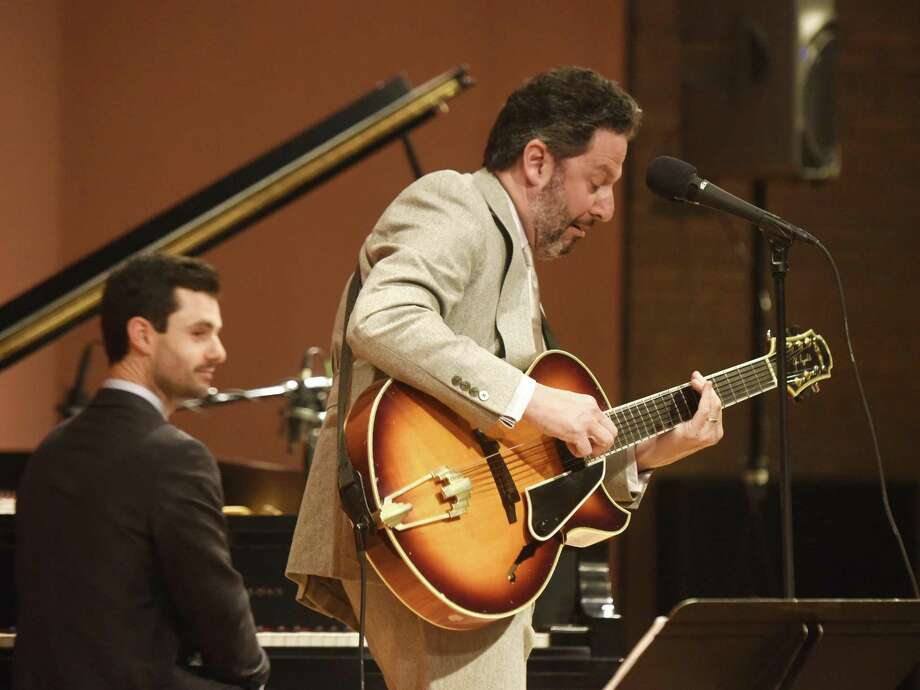Jazz guitarist and singer John Pizzarelli performs at Greenwich Library's Cole Auditorium in Greenwich, Conn. Sunday, Feb. 18, 2018. Pizzarelli is a virtuoso who performs mostly modern interpretations from the Great American Songbook. Photo: Tyler Sizemore / Hearst Connecticut Media / Greenwich Time