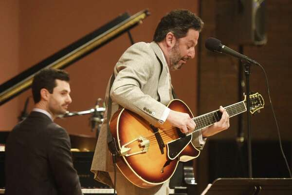 Jazz guitarist and singer John Pizzarelli performs at Greenwich Library's Cole Auditorium in Greenwich, Conn. Sunday, Feb. 18, 2018. Pizzarelli is a virtuoso who performs mostly modern interpretations from the Great American Songbook.