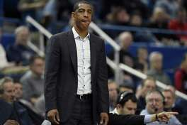 UConn coach Kevin Ollie is seen during a game earlier this season. On Sunday, Ollie's Huskies picked up a road win over East Carolina.