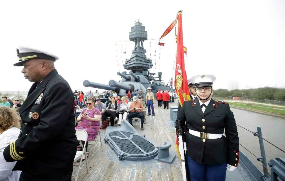Retired Navy Chaplain Gregory McCrimmon, with the Michael E Debakey VA Medical Center, left, and Alma Contreras, 17, with the ESTEM High School Jr. ROTC color guard, right, prepare to begin a program on the Battleship Texas, 3523 Independence Parkway South, Sunday, Feb. 18, 2018, in Houston. The event was in commemoration of the 73rd anniversary of the Battle of Iwo Jima. Photo: Melissa Phillip, Houston Chronicle / © 2018 Houston Chronicle