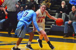EHS guard Kate Martin, right, drives past Belleville East's Kaylah Rainey.