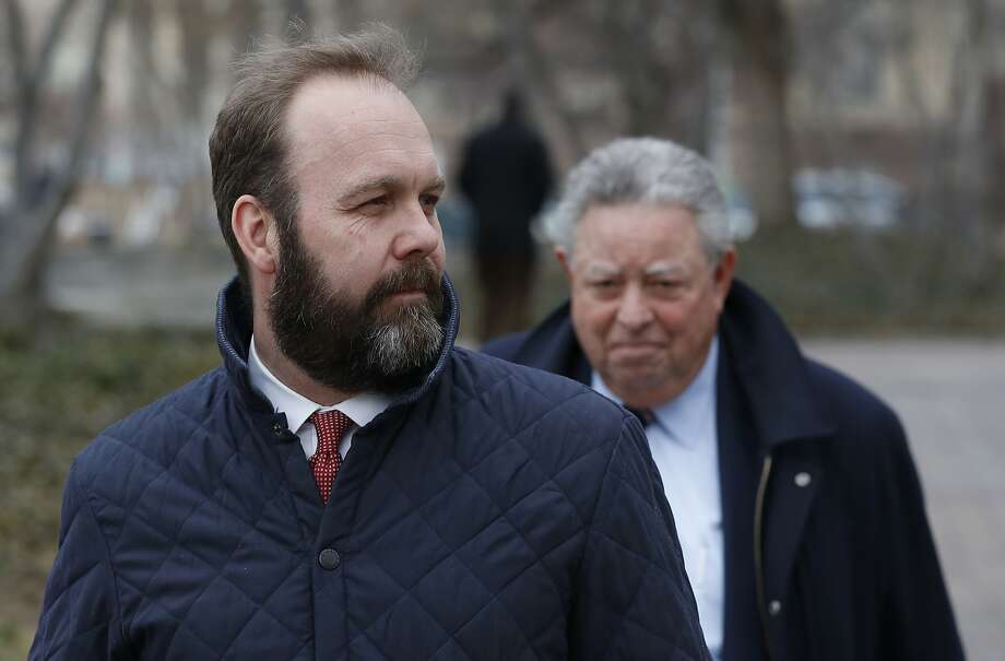 Rick Gates, left, with his lawyer Tom Green, depart Federal District Court, Wednesday, Feb. 14, 2018, in Washington. Paul Manafort, the former campaign chairman for President Donald Trump, and his business associate Rick Gates were in federal court on Wednesday for a routine status conference. Both were indicted in October on charges stemming from foreign lobbying work in Ukraine.  (AP Photo/Alex Brandon) Photo: Alex Brandon, Associated Press