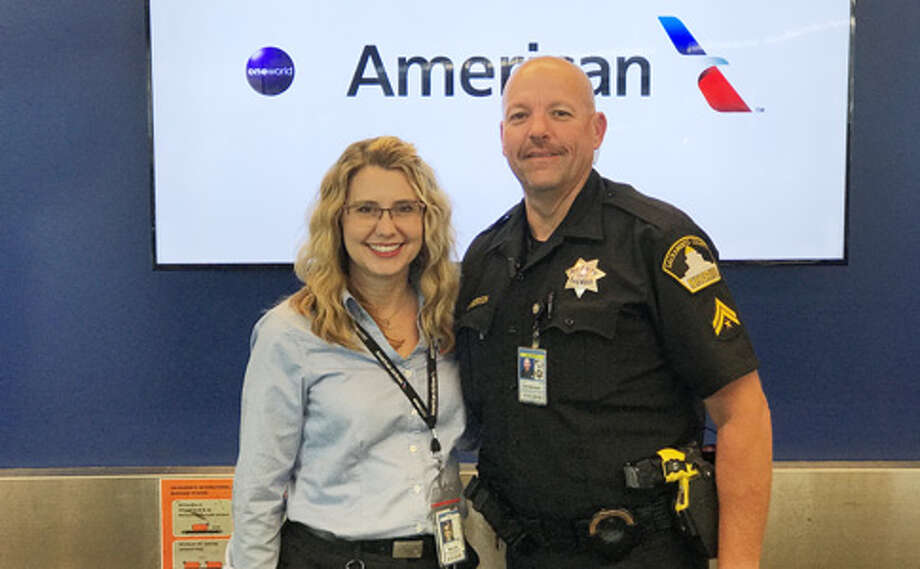 Customer Service Agent Denice Miracle and Deputy Todd Sanderson of the Sacramento County Sheriff's Department Airport Bureau. Photo: Courtesy Of American Airlines