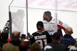 Washington Capitals right wing Devante Smith-Pelly (25) argues with Chicago Blackhawks fans from the penalty box during the third period of an NHL hockey game Saturday, Feb. 17, 2018, in Chicago. The Blackhawks won the game 7-1.(AP Photo/Jeff Haynes)