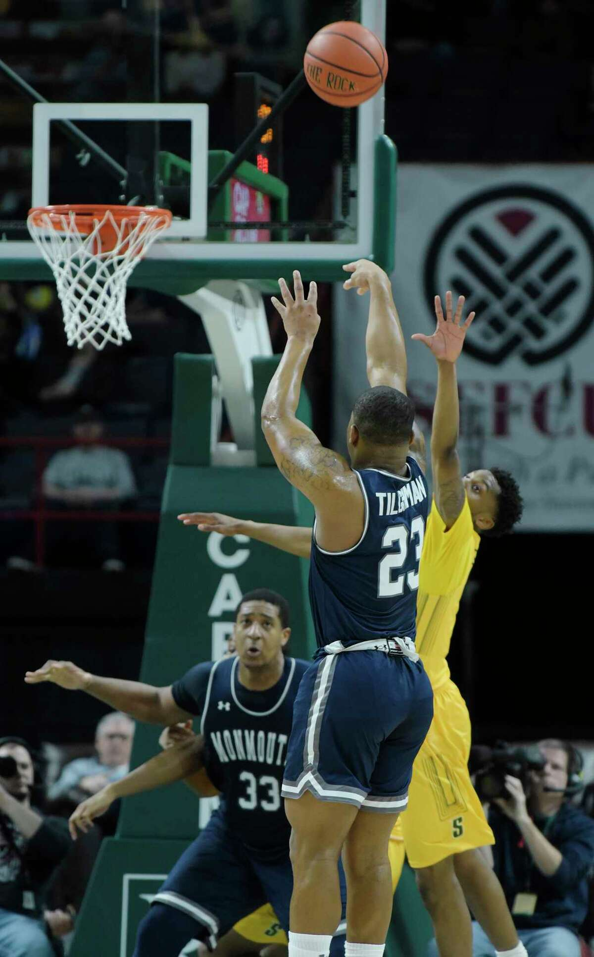 Diago Quinn of Monmouth puts up a shot as Kadeem Smithen of Siena tries to block the shot during their game on Sunday, Feb. 18, 2018, in Albany, N.Y. (Paul Buckowski/Times Union)