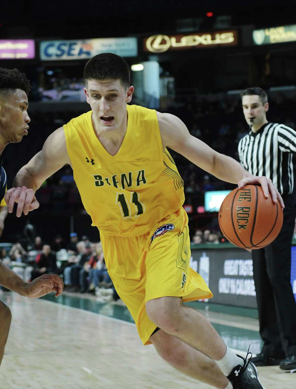 Thomas Huerter, Jr. of Siena tries to get around a Monmouth player during their game on Sunday, Feb. 18, 2018, in Albany, N.Y. (Paul Buckowski/Times Union)
