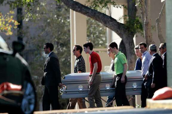 A funeral was held Sunday in Boca Raton, Fla., for teacher Scott Beigel, who was praised for his heroic efforts to save lives during Wednesday's mass shooting at Marjory Stoneman Douglas High School in Parkland. Beigel, 35, was shot and killed as he gave shelter to as many students  as he could inside his classroom. Sixteen other students and teachers were also gunned down.