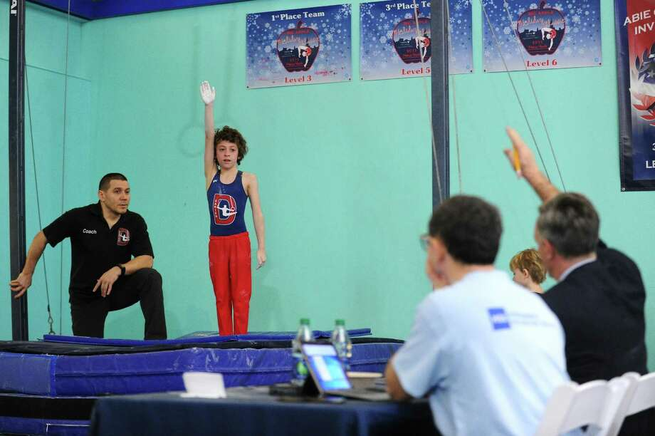 Nine-year-old Monty Bell, of Darien, performs on the rings during the fifth annual Winter Challenge gymnastics meet at Chelsea Piers on Blachley Road in Stamford, Conn. on Sunday, Feb. 18, 2018. 54 teams of approximately 900 athletes from six states participated in the annual USAG certified meet. Photo: Michael Cummo / Hearst Connecticut Media / Stamford Advocate