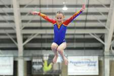 Taylor Lerow, a member of Vasi's International Gymnastics team based in Newtown, performs on the bars during the fifth annual Winter Challenge gymnastics meet at Chelsea Piers on Blachley Road in Stamford, Conn. on Sunday, Feb. 18, 2018.