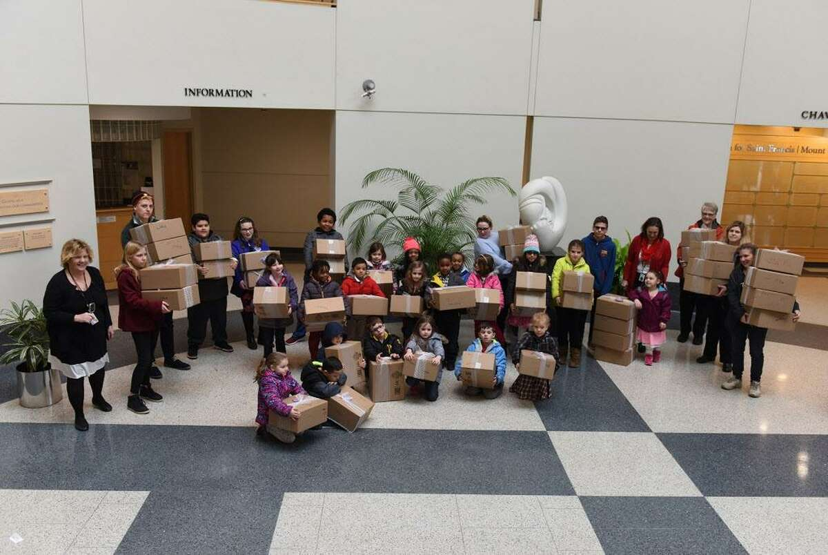 Spencer students arrive at the hospital with the Keep A Baby Warm boxes.