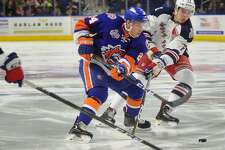 Bridgeport Sound Tiger Travis St. Denis carries the puck in to the offensive zone defended by Hartford's Filip Chytil in the first period of their AHL hockey game at the Webster Bank Arena in Bridgeport, Conn. on Sunday, February 18, 2018.
