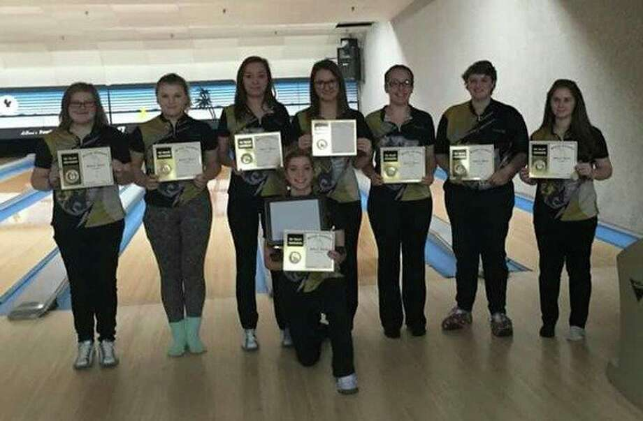The Bullock Creek girls' bowling team received its Tri-Valley Conference Central championship trophy on Saturday. Pictured, standing from left, are Angela LaPrad, Emma Ross, Dakota Evans, Savannah Schulze, Hannah Hall, Elizabeth Ancel and Allison Woolard. Kneeling in front is Skyler Rounds. Not pictured is Makenna Bass. (Photo provided by Del Bolesky)