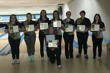 The Bullock Creek girls' bowling team received its Tri-Valley Conference Central championship trophy on Saturday. Pictured, standing from left, are Angela LaPrad, Emma Ross, Dakota Evans, Savannah Schulze, Hannah Hall, Elizabeth Anceland Allison Woolard. Kneeling in front isSkyler Rounds. Not pictured is Makenna Bass. (Photo provided by Del Bolesky)