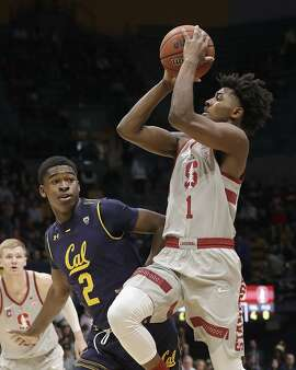 Stanford guard Daejon Davis (1) shoots against California guard Juhwan Harris-Dyson (2) during the first half of an NCAA college basketball game in Berkeley, Sunday, Feb. 18, 2018. (AP Photo/Jeff Chiu)
