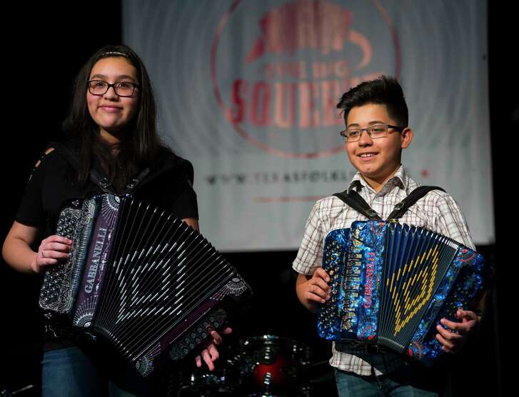 Big Squeeze contestants Aryana Dueñez, 13, and Ricky Casarez, 13, smile on stage during the Big Squeeze regional contest for Conjunto players at MECA, Sunday, Feb. 18, 2018, in Houston.
