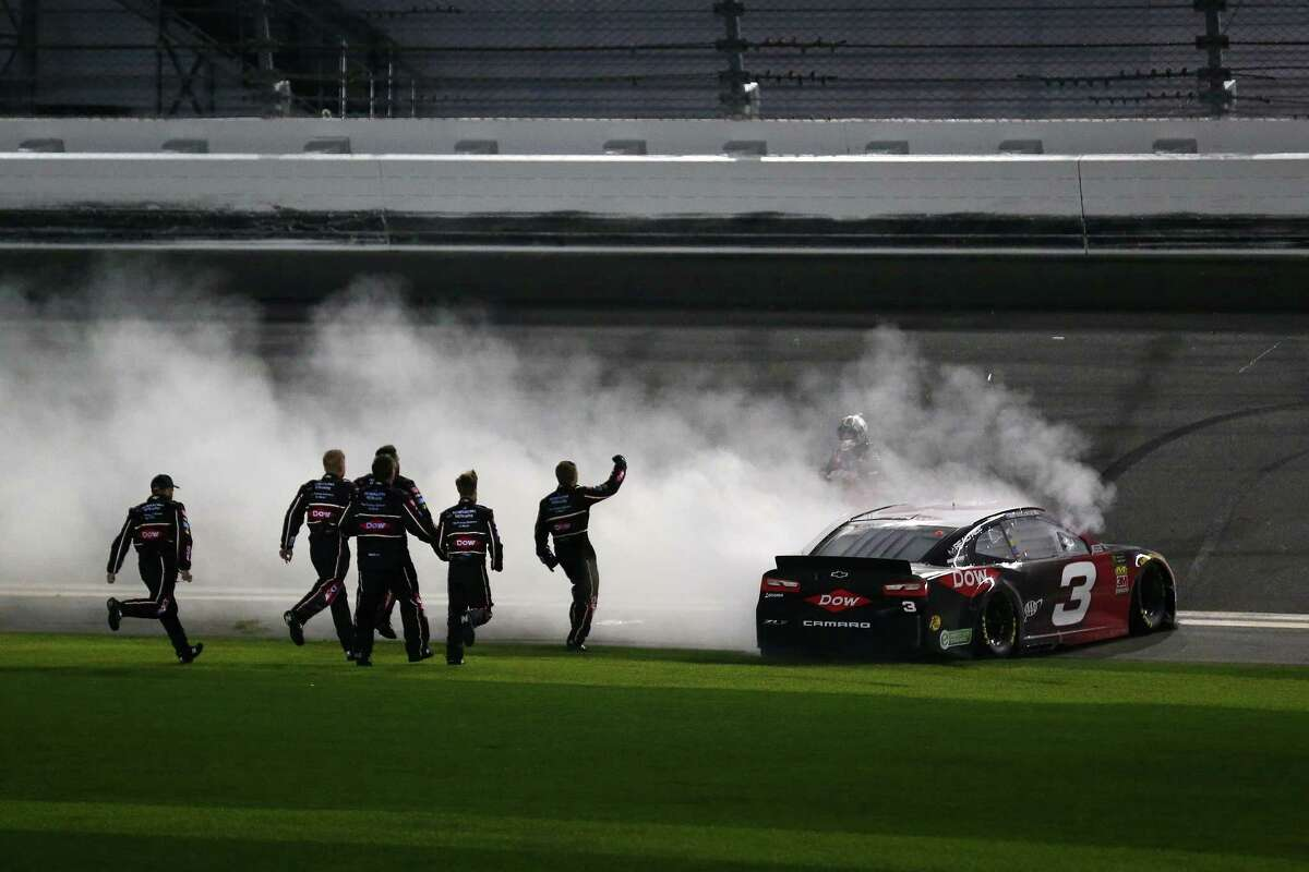 DAYTONA BEACH, FL - FEBRUARY 18: Austin Dillon, driver of the #3 DOW Chevrolet, and crew celebrate winning the Monster Energy NASCAR Cup Series 60th Annual Daytona 500 at Daytona International Speedway on February 18, 2018 in Daytona Beach, Florida. (Photo by Sarah Crabill/Getty Images)