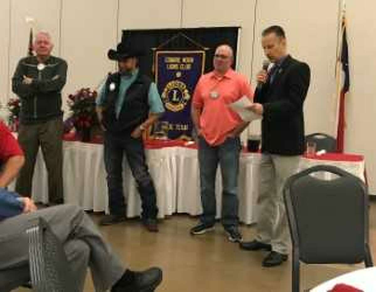 """Conroe Noon Lions Club members, from left to right, Bob Gunter, Jason Miller, and Philip Dupuis field questions from emcee Mike Sproba, right, in the 'Not so New �"""" Newlywed' game as part of the clubs Sweetheart's Day festivities."""