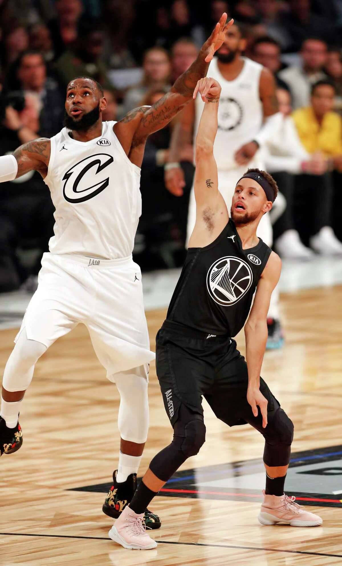 Team Stephen's Stephen Curry and Team LeBron's LeBron James watch Curry's 3-point attempt in 2nd quarter during NBA All Star Game at Staples Center in Los Angeles, Calif., on Sunday, February 18, 2018.