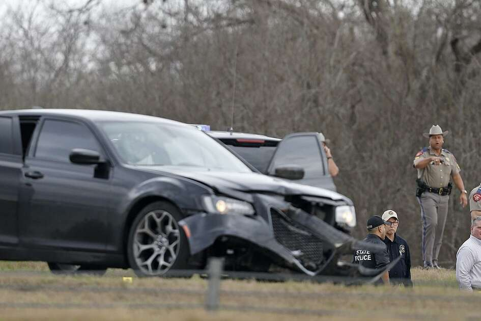 Emergency personnel work the scene where a DPS trooper was shot Sunday Feb. 18, 2018 at IH-10 and Graytown Road.