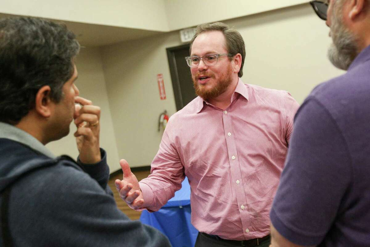 Steven David, candidate for U.S. Rep. District 8, speaks with residents during the meet and greet with state and local Democratic Party candidates on Sunday at the Activity Center in Conroe.