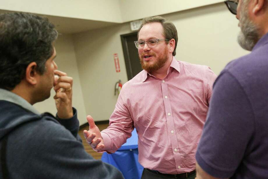 Steven David, candidate for U.S. Rep. District 8, speaks with residents during the meet and greet with state and local Democratic Party candidates on Sunday at the Activity Center in Conroe. Photo: Michael Minasi, Staff Photographer / © 2017 Houston Chronicle