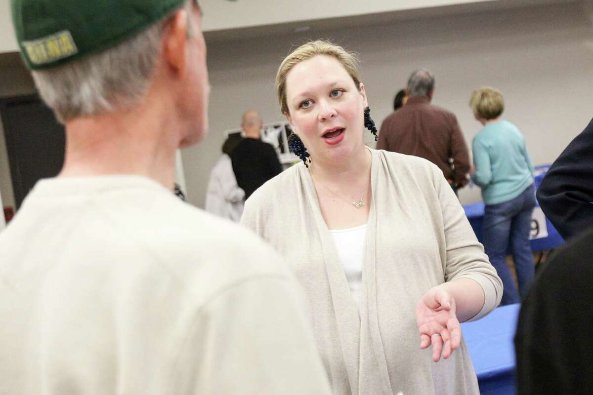 Claire Lindsay, candidate for Precinct 3 Justice of the Peace, speaks with residents during the meet and greet with state and local Democratic Party candidates on Sunday, Feb. 18, 2018, at the Activity Center in Conroe.