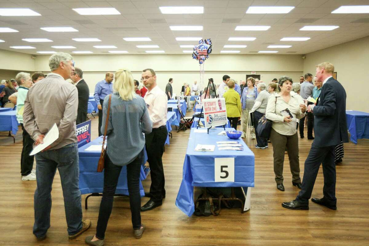State and local Democratic Party candidates mingle with residents during a meet a greet on Sunday, Feb. 18, 2018, at the Activity Center in Conroe.