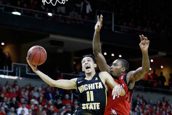 Landry Shamet scored 19 points as 19th-ranked Wichita State ended No. 5 Cincinnati's 39-game home winning streak and tightened the AAC race.