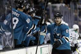 San Jose Sharks' Mikkel Boedker, right, celebrates his goal with teammates during the first period of an NHL hockey game against the Dallas Stars, Sunday, Feb. 18, 2018, in San Jose, Calif. (AP Photo/Marcio Jose Sanchez)